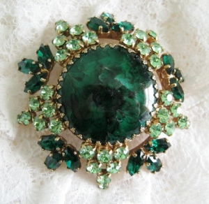 Above: a fake malachite costume jewellery brooch. The centre faux-malachite is made from plastic, and the surrounding rhinestones are glass.
