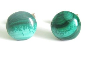 Genuine real solid malachite gemstone cufflinks. Notice the sheer variety of colourization and patterns, from standard stripes to waves and unusual speckles.