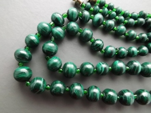 Real genuine malachite gemstone beads (the smaller green spacer beads are glass, this is quite normal on this type of necklace).
