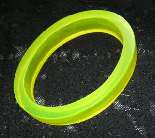 Vintage 1990s rave fluorescent oval bangle yellow glow dark jewelry