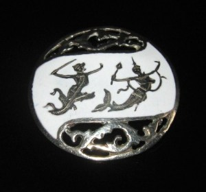 White enamel Siam silver brooch shows Hanuman (the Monkey King) and Matcha (Queen of the Mermaids).