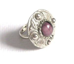 ABOVE: A modern reproduction Celtic style ring, with purple glass imitation agate. Notice how the metal work is the focus of the jewellery, not the stone. In genuine antique Scottish jewellery it is the other way round - the focus is on the stone work, not the metal.