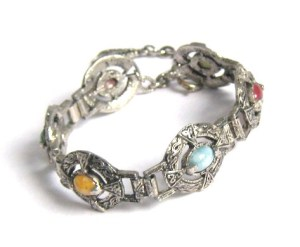 ABOVE: A modern (circa 1980s) Scottish Celtic bracelet, with glass imitation agates. Compare this bracelet, and the above ring with the Victorian brooches. Notice how the patterns and scroll work are chunkier and more crude in modern items - this helps when trying to date Scottish jewellery.