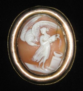 A Victorian nicely carved shell cameo brooch, depicting Hebe and Zeus as an eagle, from Roman mythology.