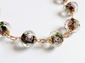 These beautiful faceted glass beads were made in China, and feature black and agoldstone effect centre colours, with pink flower detail inside of the bead.