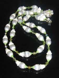 Adorable vintage white shimmering plastic bead 2 row necklace costume jewelry, with flower and leaf bead caps. Made in Japan, circa 1960s.