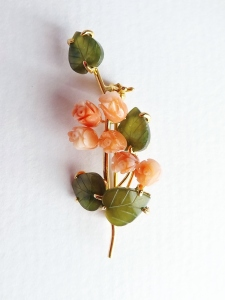 Stunning gold plated brooch, featuring carved pink coral gemstone flowers and green jade leaves.