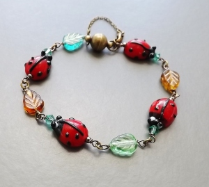 Handmade nature ladybird lampwork glass bracelet stylish bronze colour magnetic clasp, with a safety chain for added security