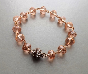A fancy diamante studded magnetic copper clasp fitted to a glass bead bracelet.