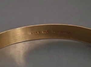 "Helpful jewellers stamping ""rolled gold"" on the bangle rather than confusing us with mysterious fractions and letters."
