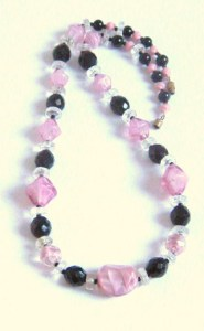 Vintage art deco pink swirl and French jet black glass chunky opera length bead necklace