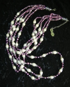 Beautiful statement freshwater cultured pearl bib necklace in lilac purple and cream beads.
