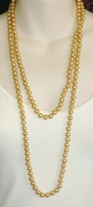 Vintage 1980s golden glass pearl knotted long flapper necklace