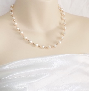 Handmade peach freshwater cultured pearl bead necklace, with rose gold tone links.