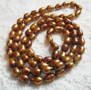 Golden colour freshwater cultured pearl bead opera length necklace