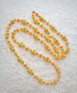 Vintage 1970s plastic orange glass flower bead long necklace