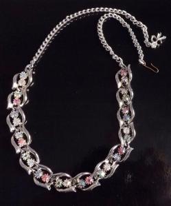 Vintage circa 1960s pink and blue glass rhinestone paste swirl collar necklace