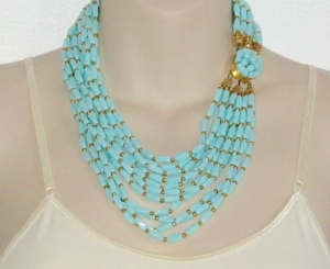 vintage circa 1960s layered turquoise plastic bead bib multi row statement gold tone necklace