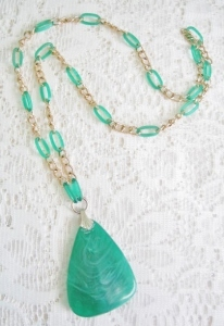 Vintage circa 1980s green plastic pendant statement necklace, with huge pendant.