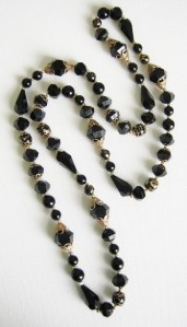 Vintage 1980s faux French Jet and gold detail long fancy bead necklace, with black plastic beads.
