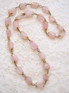 Vintage circa 1970s rose quartz gemstone bead necklace, in rose gold tone metal.