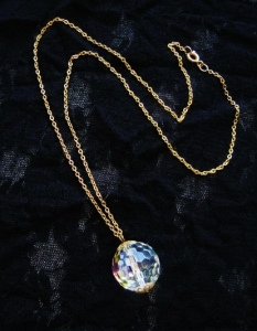 Vintage circa 1980s long gold plated chain necklace, with huge statement faceted aurora AB crystal ball pendant