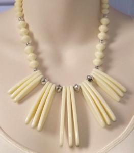 Vintage circa 1980s statement cream plastic bib necklace, with large dagger drops