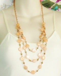 Rose gold colour metallic costume jewellery chain bib necklace, detailed with peach shells.