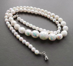 Vintage circa 1960s milk glass white faceted bead necklace, with carnival glass lustre effect rainbow coating.
