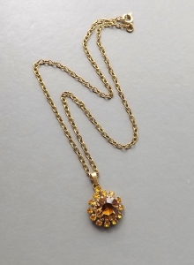 Vintage circa 1970s brown glass paste rhinestone pendant necklace, with gold tone chain