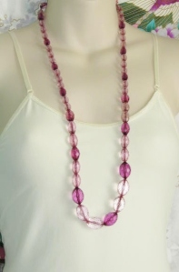 Vintage 1980s faceted plastic long chunky bead necklace, with lilac and purple beads.