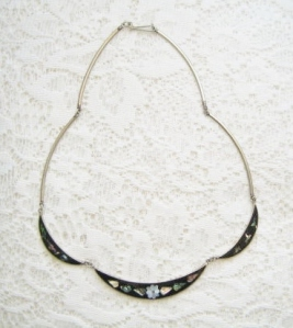 Vintage circa 1980s mother of pearl and black enamel inlay collar necklace in silver tone metal.