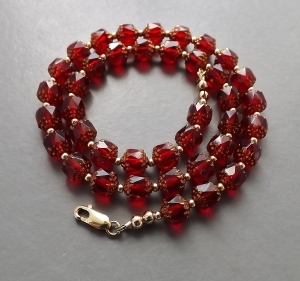 Ruby red Czech cathedral cut glass bead necklace, with rolled gold clasp and beads.