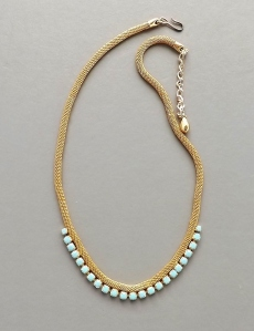 Vintage 1960s gold tone mesh necklace, detailed with turquoise glass rhinestone pastes.