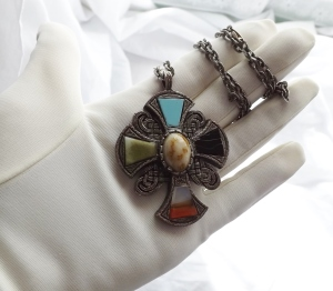 Large vintage Scottish style cross pendant necklace, detailed with glass agate stones, on dark silver tone metal.