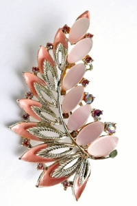 I strongly suspect this vintage 1960s pink enamel and thermoplastic brooch contained high levels of lead; the worn off gold plating revealed dull dark silver-colour metal underneath, and the metal was so soft and malleable it would have broken with the slightest of pressure.