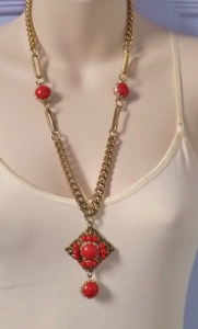 Vintage circa 1970s faux coral and gold tone statement pendant bead necklace, signed West Germany.